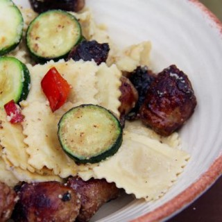 Easy Spicy Sausages with Ravioli, Zucchini and Peppers